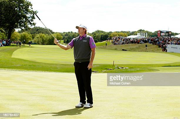 Brandt Snedeker catches his putter after throwing it in the air after missing a putt on the 18th green during the Final Round of the BMW Championship...