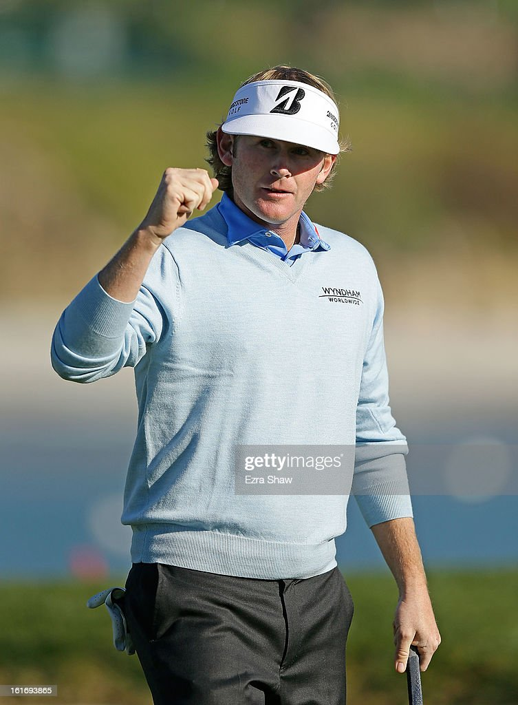 Brandt Snedeker celebrates a putt on the 17th green during the final round of the AT&T Pebble Beach National Pro-Am at Pebble Beach Golf Links on February 10, 2013 in Pebble Beach, California.