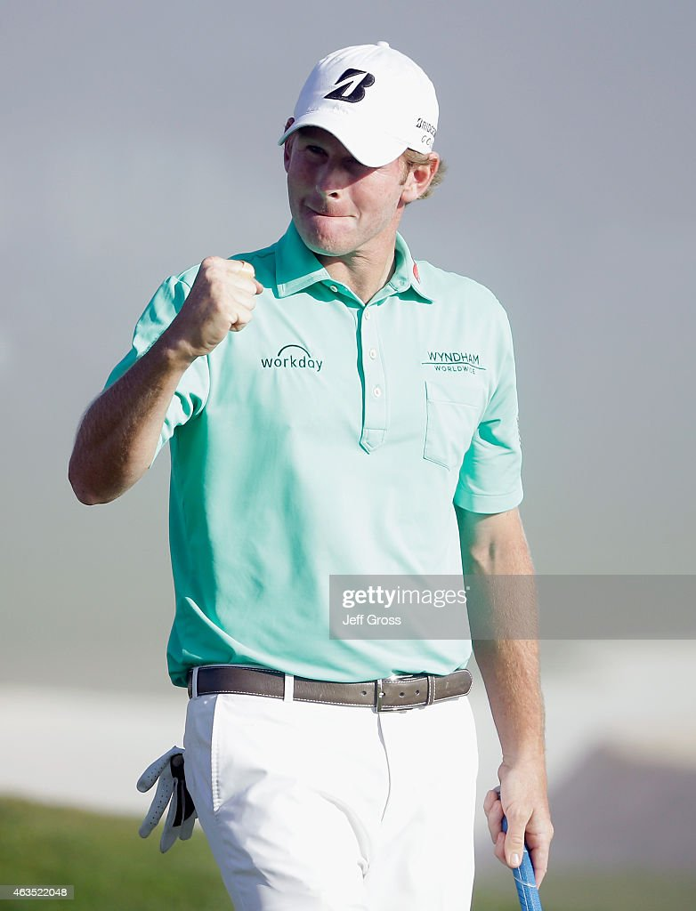 Brandt Snedeker celebrates his three-stroke victory at the AT&T Pebble Beach National Pro-Am at the Pebble Beach Golf Links on February 15, 2015 in Pebble Beach, California.