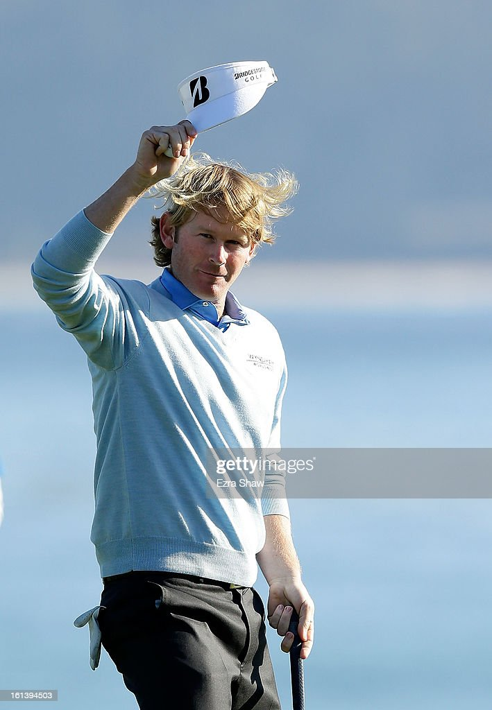 Brandt Snedeker celebrates on the 18th green after his two-stroke victory at the AT&T Pebble Beach National Pro-Am at Pebble Beach Golf Links on February 10, 2013 in Pebble Beach, California.