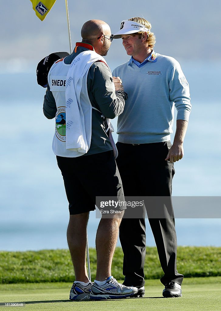 Brandt Snedeker celebrates with his caddie Scott Vail on the 18th green after his two-stroke victory at the AT&T Pebble Beach National Pro-Am at Pebble Beach Golf Links on February 10, 2013 in Pebble Beach, California.