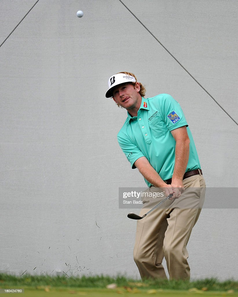 Brandt Snedeker hits a chip shot on the ninth hole during the first round of the BMW Championship at Conway Farms Golf Club on September 12, 2013 in Lake Forest, Illinois.