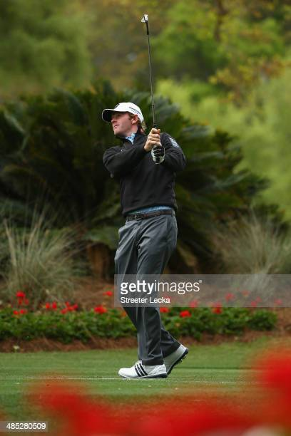 Brandt Snedeker hits his second shot on the 14th hole during the first round of the RBC Heritage at Harbour Town Golf Links on April 17 2014 in...
