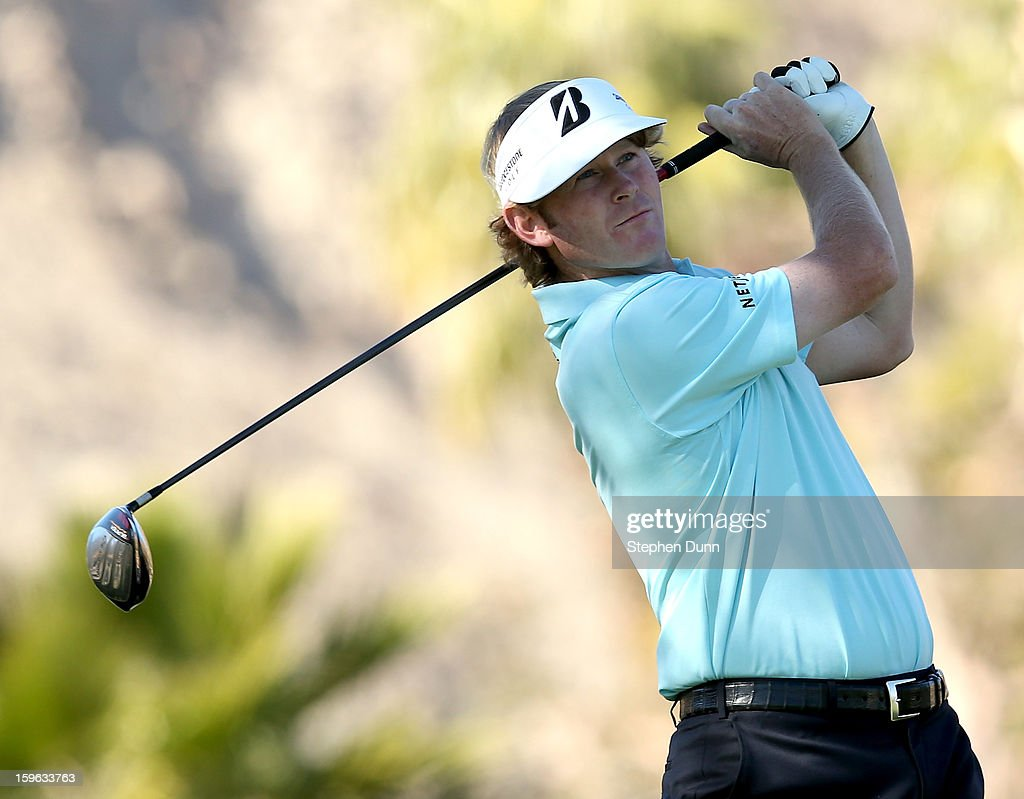 Brandt Snedeker hits his tee shot on the 11th hole during the first round of the Humana Challenge in partnership with the Clinton Foundation at La Quinta Country Club on January 17, 2013 in La Quinta, California.