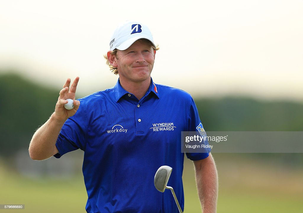 Brandt Snedeker of the United States acknowledges the crowd after putting in on the 18th green during the final round of the RBC Canadian Open at...