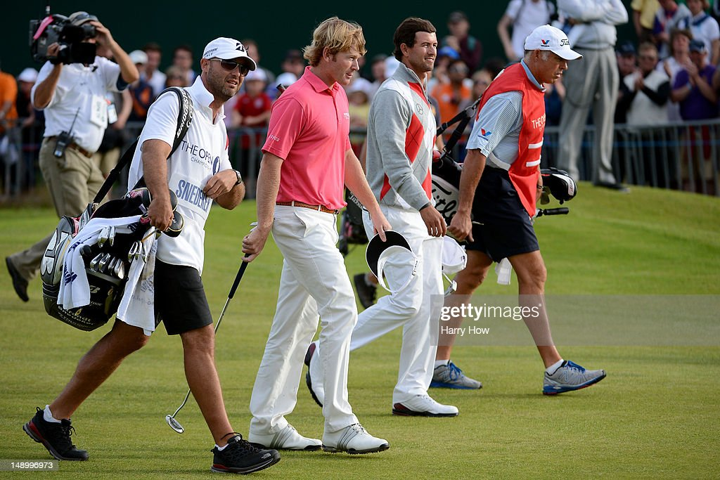 Brandt Snedeker of the United States and Adam Scott of Australia walk down the eighteenth fairway the eighteenth hole during the third round of the 141st Open Championship at Royal Lytham & St. Annes Golf Club on July 21, 2012 in Lytham St Annes, England.