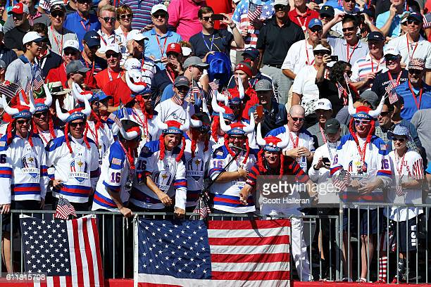 Brandt Snedeker of the United States cheers in the stands with fans during afternoon fourball matches of the 2016 Ryder Cup at Hazeltine National...