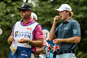 Brandt Snedeker of the United States eats with his caddie Scott Vail during round three of the 2016 RBC Canadian Open at Glen Abbey Golf Course on...