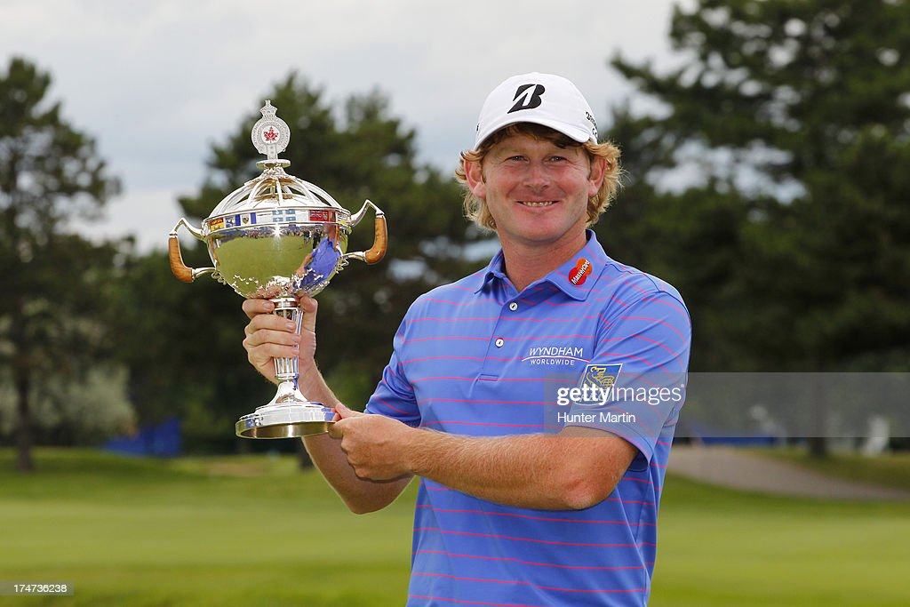 <a gi-track='captionPersonalityLinkClicked' href=/galleries/search?phrase=Brandt+Snedeker&family=editorial&specificpeople=2345049 ng-click='$event.stopPropagation()'>Brandt Snedeker</a> of the United States holds the championship trophy after winning the RBC Canadian Open at Glen Abby Golf Club on July 28, 2013 in Oakville, Ontario, Canada.