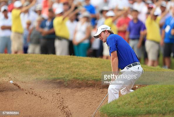 Brandt Snedeker of the United States plays his shot out of the bunker on the 18th green during the final round of the RBC Canadian Open at Glen Abbey...