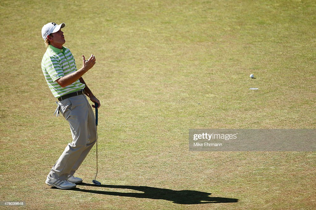 Brandt Snedeker of the United States reacts to a missed putt on the 12th green during the final round of the 115th U.S. Open Championship at Chambers Bay on June 21, 2015 in University Place, Washington.
