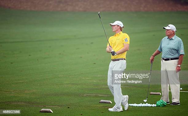 Brandt Snedeker of the United States works on the practice ground with Butch Harmon during a practice round prior to the start of the 2015 Masters...
