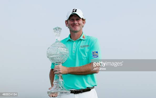 Brandt Snedeker poses with the trophy after his threestroke victory at the ATT Pebble Beach National ProAm at the Pebble Beach Golf Links on February...