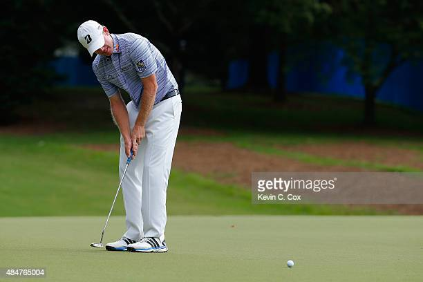 Brandt Snedeker putts on the 1st green during the second round of the Wyndham Championship at Sedgefield Country Club on August 21 2015 in Greensboro...