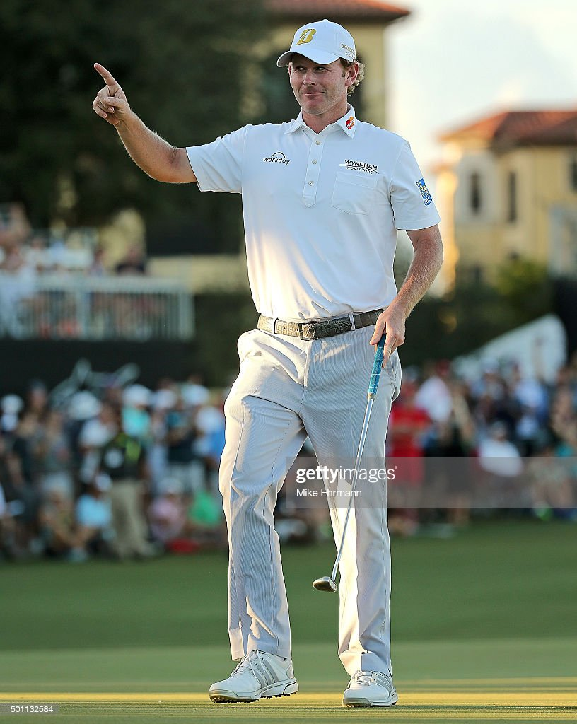 Brandt Snedeker reacts to a birdie putt on the 18th hole during the final round of the Franklin Templeton Shootout at Tiburon Golf Club on December 12, 2015 in Naples, Florida.
