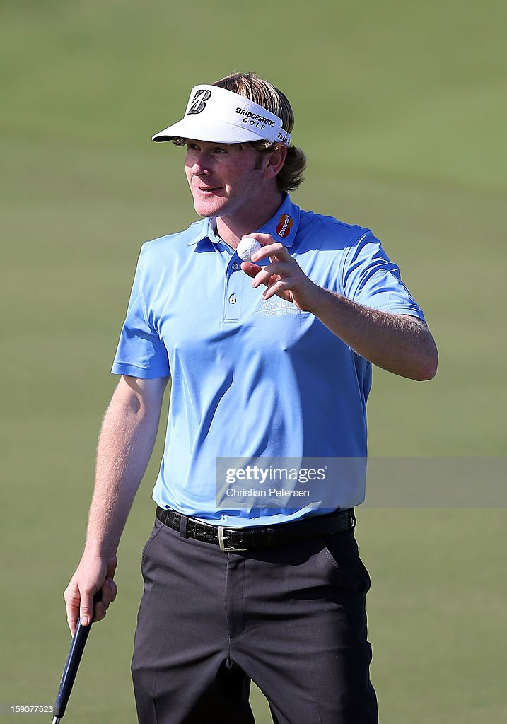 Brandt Snedeker reacts to the fans after making a birdie putt on the ninth hole green during the replay of the first round of the Hyundai Tournament of Champions at the Plantation Course on January 7, 2013 in Kapalua, Hawaii.