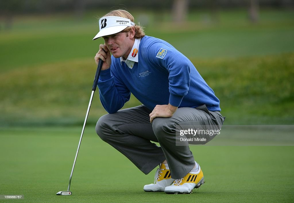 Brandt Snedeker studies the green during the First Round at the Farmers Insurance Open at Torrey Pines Golf Course on January 24, 2013 in La Jolla, California.