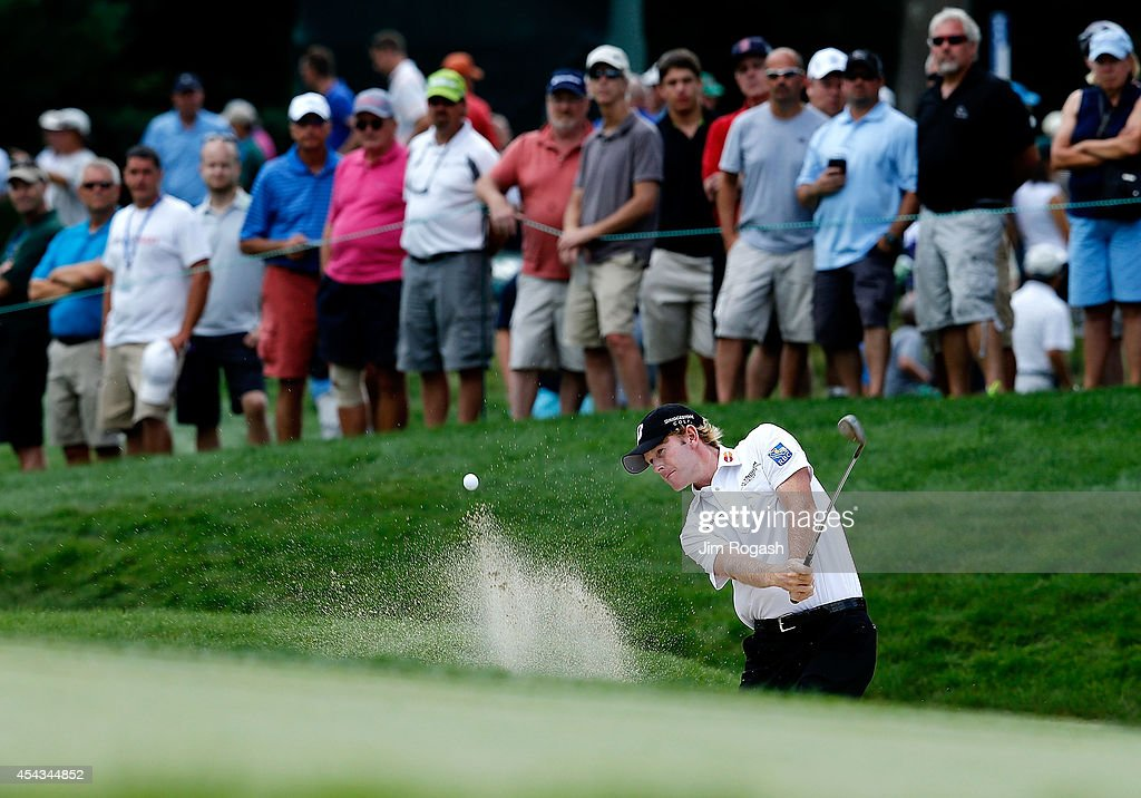 Brandt Snedeker takes his shot out of the bunker on the seventh hole during the first round of the Deutsche Bank Championship at the TPC Boston on...