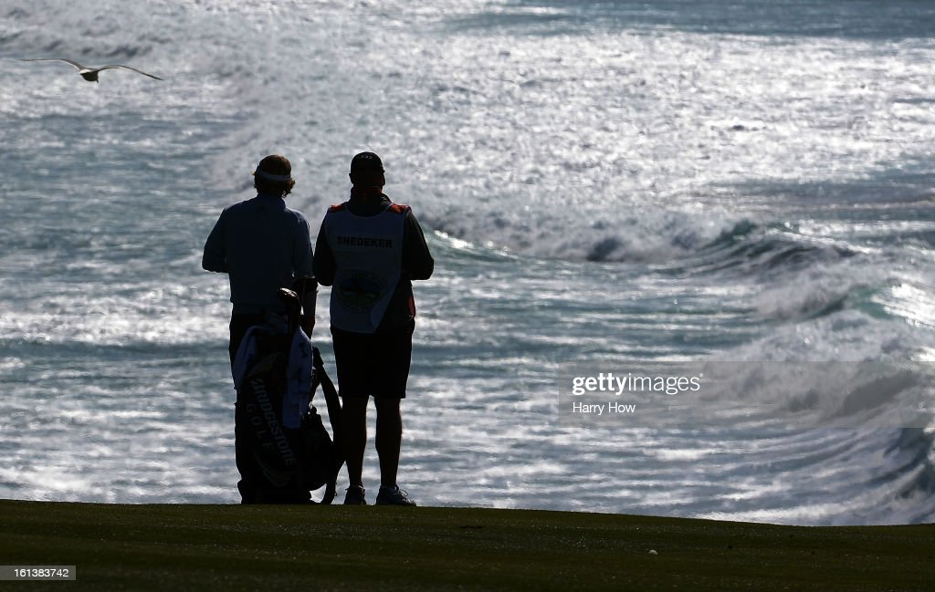 Brandt Snedeker waits with his caddie Scott Vail on the eighth hole as a seagull passes overhead during the final round of the AT&T Pebble Beach National Pro-Am at Pebble Beach Golf Links on February 10, 2013 in Pebble Beach, California.