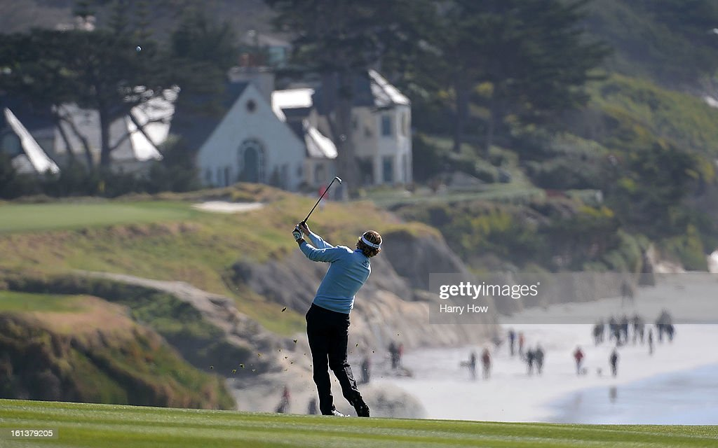 Brandt Snedeker watches his approach shot on the ninth hole during the final round of the AT&T Pebble Beach National Pro-Am at Pebble Beach Golf Links on February 10, 2013 in Pebble Beach, California.