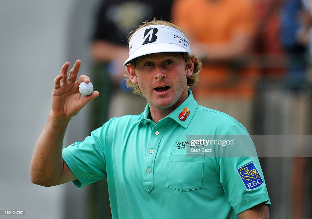 Brandt Snedeker waves his golf ball as he exits the ninth hole during the first round of the BMW Championship at Conway Farms Golf Club on September 12, 2013 in Lake Forest, Illinois.