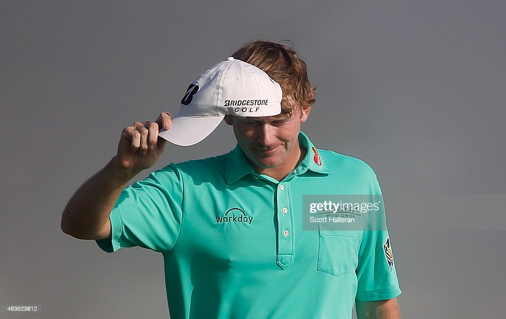 Brandt Snedeker waves to the gallery as he walks to the 18th green during the final round of the AT&T Pebble Beach National Pro-Am at the Pebble Beach Golf Links on February 15, 2015 in Pebble Beach, California.
