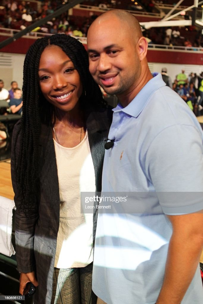 Brandy Norwood and Demetrius Spencer attends the Ball Up 'Search For the Next' Tour Celebrity Game at Megafest on August 31, 2013 in Dallas, United States.