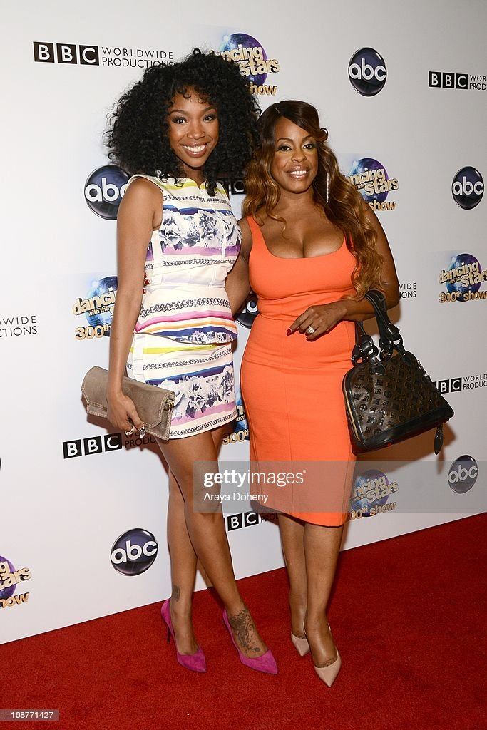 Brandy Norwood and Niecy Nash arrive at the 'Dancing With The Stars' 300th episode red carpet event on May 14, 2013 in Los Angeles, California.
