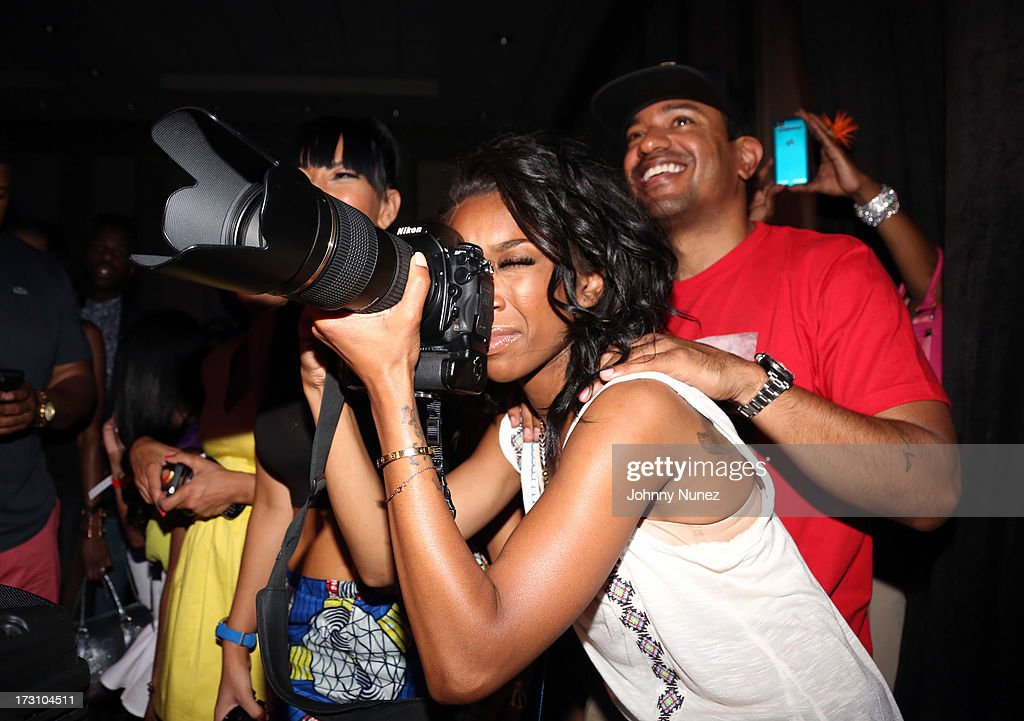 Brandy Norwood (c) and Ryan Press (r) attend the Essence Day party at the W New Orleans on July 6, 2013 in New Orleans, Louisiana.