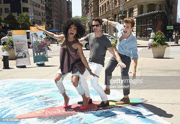 Brandy Norwood Nate Berkus and Jeremiah Brent ride a 3D wave to celebrate the Anaheim/Orange County Visitor Conventions Bureau New Brand Debut at...