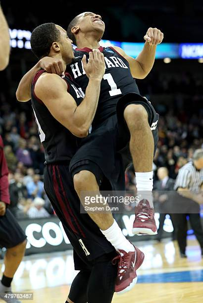 Brandyn Curry and Siyani Chambers of the Harvard Crimson celebrate after they beat the Cincinnati Bearcats during the second round of the 2014 NCAA...