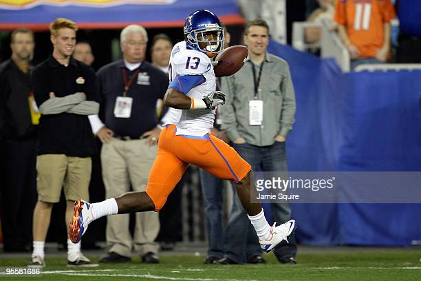 Brandyn Thompson of the Boise State Broncos runs into the endzone after a 50yard interception return for a touchdown in the first quarter against the...