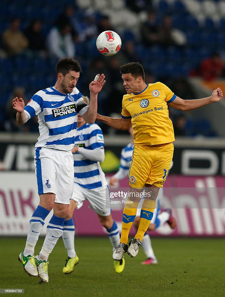 Branimir Bajic of Duisburg and Oliver Petersch of Braunschweig compete for the ball during the Second Bundesliga match between MSV Duisburg and Eintracht Braunschweig at Schauinsland-Reisen-Arena on March 4, 2013 in Duisburg, Germany.