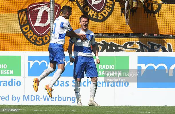 Branimir Bajic of Duisburg jubilates with Enis Hajri after team mate Kingsley Onuegbu scoring the first goal during the third league match between SG...