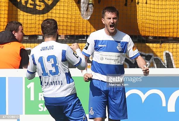 Branimir Bajic of Duisburg jubilates with Zlatko Janijc after team mate Kingsley Onuegbu scoring the first goal during the third league match between...