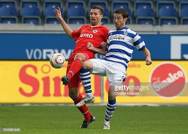 Branimir Bajicl of Duisburg challenges Ronny Koenig of Oberhausen during the Second Bundesliga match between MSV Duisburg and RW Oberhausen at...