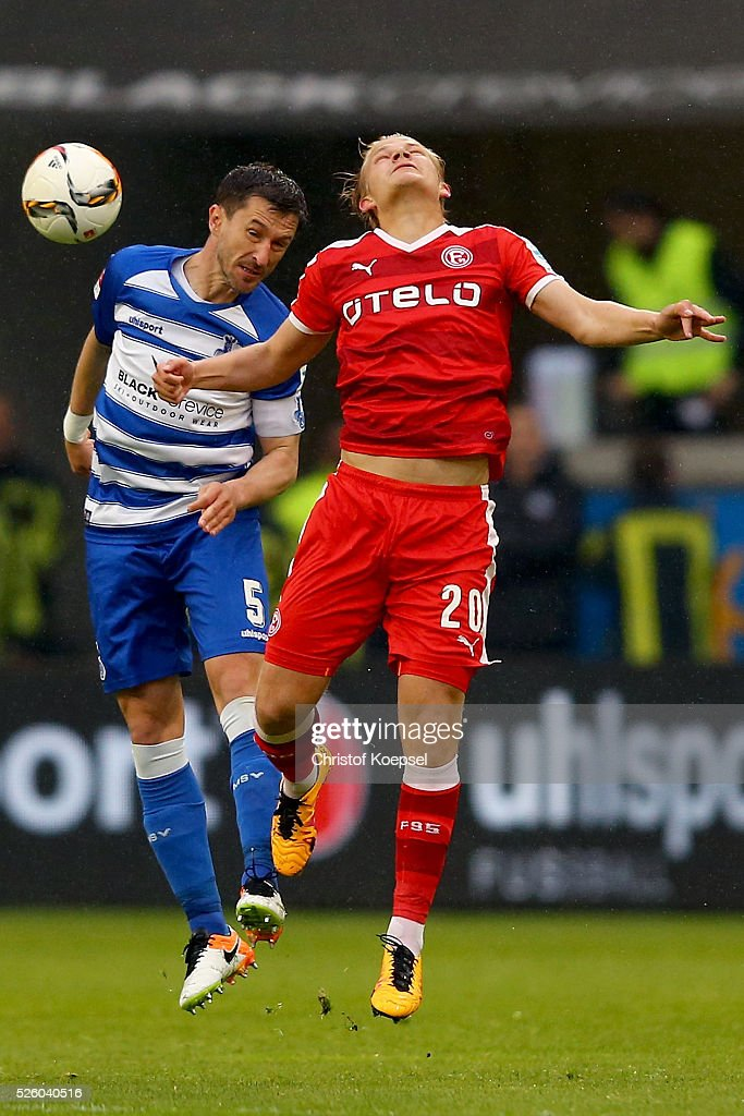 Branimir Branjic of Duisburg and Joel Pohjanpalo of Duesseldorf go up for a header during the 2. Bundesliga match between MSV Duisburg and Fortuna Duesseldorf at Schauinsland-Reisen-Arena on April 29, 2016 in Duisburg, Germany.
