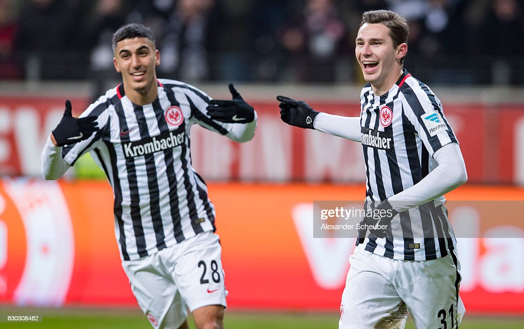 Branimir Hrgota of Frankfurt celebrates the third goal for his team with Aymane Barkok of Frankfurt during the Bundesliga match between Eintracht Frankfurt and 1. FSV Mainz 05 at Commerzbank-Arena on December 20, 2016 in Frankfurt am Main, Germany.