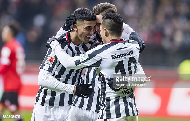Branimir Hrgota of Frankfurt celebrates the third goal for his team with Aymane Barkok of Frankfurt and Marco Fabian of Frankfurt during the...
