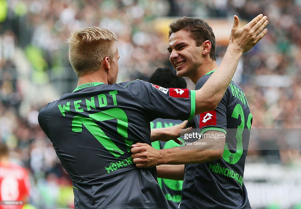 Branimir Hrgota (R) of Moenchengladbach celebrates his team's first goal with team mate Oscar Wendt during the Bundesliga match between 1. FSV Mainz 05 and VfL Borussia Moenchengladbach at Coface Arena on May 11, 2013 in Mainz, Germany.