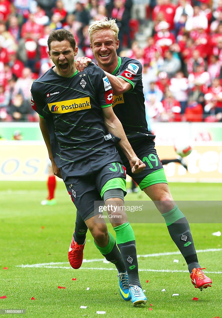 Branimir Hrgota (front) of Moenchengladbach celebrates his team's first goal with team mate <a gi-track='captionPersonalityLinkClicked' href=/galleries/search?phrase=Mike+Hanke&family=editorial&specificpeople=206515 ng-click='$event.stopPropagation()'>Mike Hanke</a> during the Bundesliga match between 1. FSV Mainz 05 and VfL Borussia Moenchengladbach at Coface Arena on May 11, 2013 in Mainz, Germany.