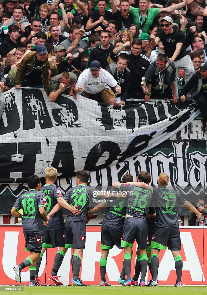 Branimir Hrgota of Moenchengladbach celebrates his team's second goal with team mates and fans during the Bundesliga match between 1. FSV Mainz 05 and VfL Borussia Moenchengladbach at Coface Arena on May 11, 2013 in Mainz, Germany.