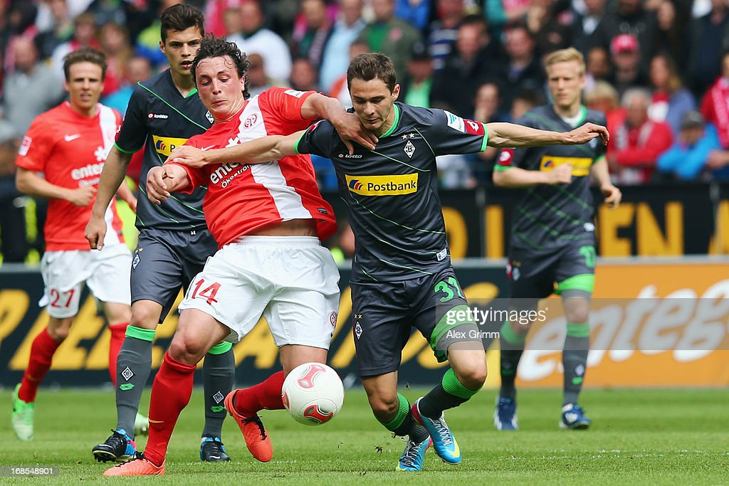 Branimir Hrgota (R) of Moenchengladbach is challenged by Julian Baumgartlinger of Mainz during the Bundesliga match between 1. FSV Mainz 05 and VfL Borussia Moenchengladbach at Coface Arena on May 11, 2013 in Mainz, Germany.