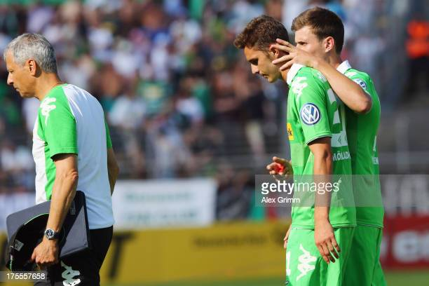 Branimir Hrgota of Moenchengladbach is comforted by team mate Havard Nordtveit after he missed the final penalty during the penalty shootout of the...