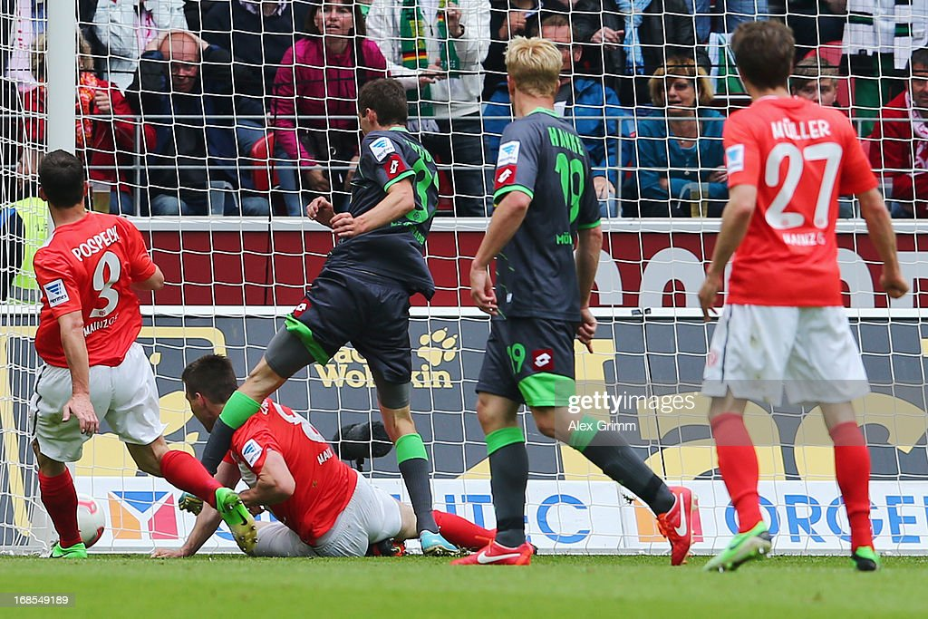 Branimir Hrgota (C) of Moenchengladbach scores his team's second goal during the Bundesliga match between 1. FSV Mainz 05 and VfL Borussia Moenchengladbach at Coface Arena on May 11, 2013 in Mainz, Germany.