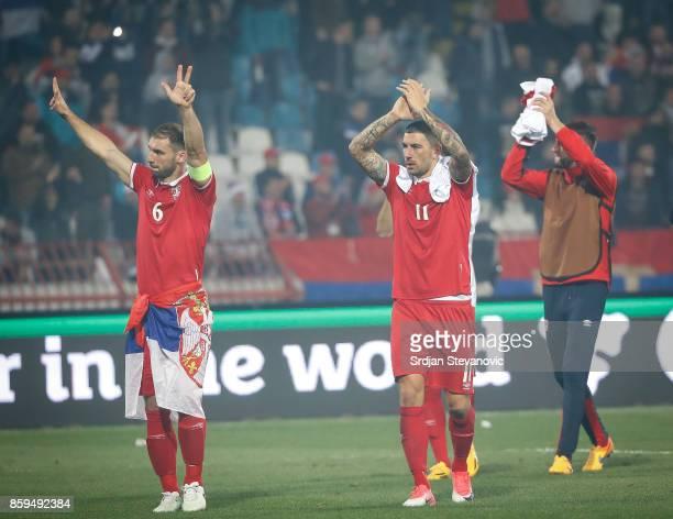 Branislav Ivanovic and Aleksandar Kolarov of Serbia celebrate their victory after FIFA 2018 World Cup Qualifier between Serbia and Georgia at stadium...