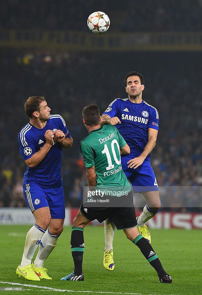 Branislav Ivanovic and Cesc Fabregas of Chelsea battle with Julian Draxler of Schalke during the UEFA Champions League Group G match between Chelsea FC and FC Schalke 04 on September 17, 2014 in London, United Kingdom.
