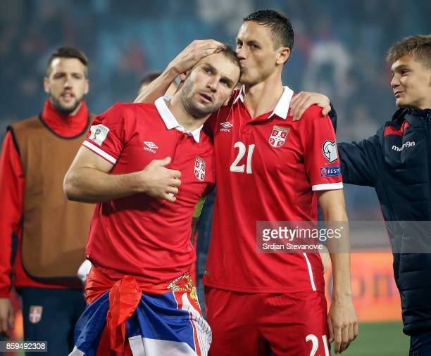Branislav Ivanovic and Nemanja Matic of Serbia celebrate their victory after FIFA 2018 World Cup Qualifier between Serbia and Georgia at stadium...