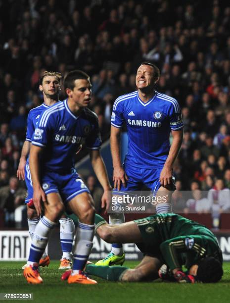 Branislav Ivanovic Cesar Azpilicueta John Terry and Petr Cech of Chelsea react as Fabian Delph of Aston Villa scores the first goal during the...