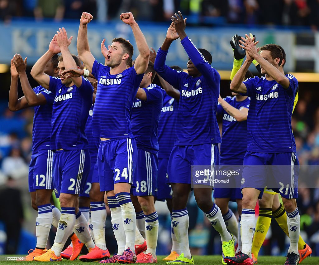 <a gi-track='captionPersonalityLinkClicked' href=/galleries/search?phrase=Branislav+Ivanovic&family=editorial&specificpeople=607152 ng-click='$event.stopPropagation()'>Branislav Ivanovic</a>, <a gi-track='captionPersonalityLinkClicked' href=/galleries/search?phrase=Gary+Cahill&family=editorial&specificpeople=204341 ng-click='$event.stopPropagation()'>Gary Cahill</a> and <a gi-track='captionPersonalityLinkClicked' href=/galleries/search?phrase=Kurt+Zouma&family=editorial&specificpeople=7905425 ng-click='$event.stopPropagation()'>Kurt Zouma</a> of Chelsea celebrate the 1-0 victory after the Barclays Premier League match between Chelsea and Manchester United at Stamford Bridge on April 18, 2015 in London, England.